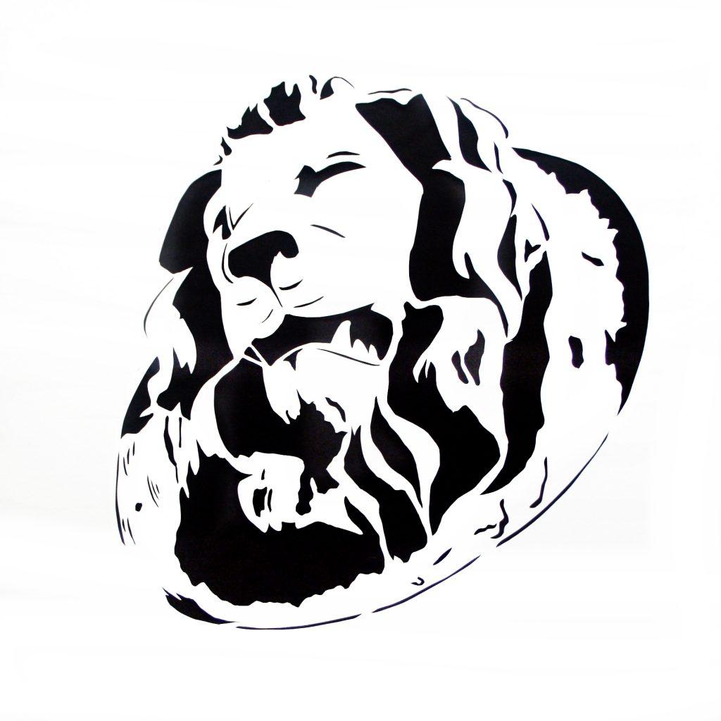 Das Foto zeigt ein Fassadenstuck an der Apotheke in der Rendsburger Altstadt, es besteht aus einem Löwenkopf.